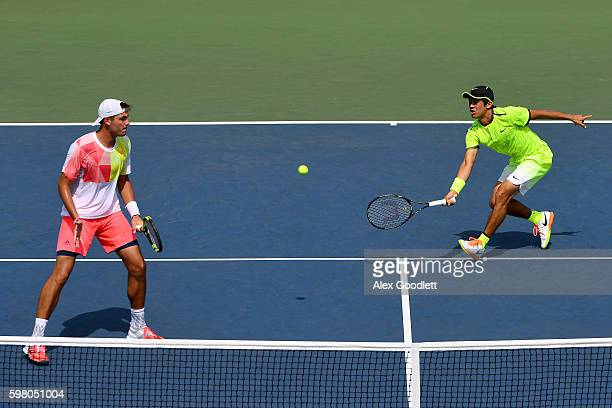 Martin Redlicki of the United States and Mackenzie McDonald of the United States in action against PierreHugues Herbert of France and Nicolas Mahut...
