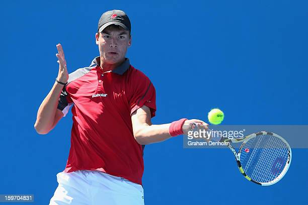 Martin Redlicki of United States of America plays a forehand in his first round match against Borna Coric of Croatia during the 2013 Australian Open...