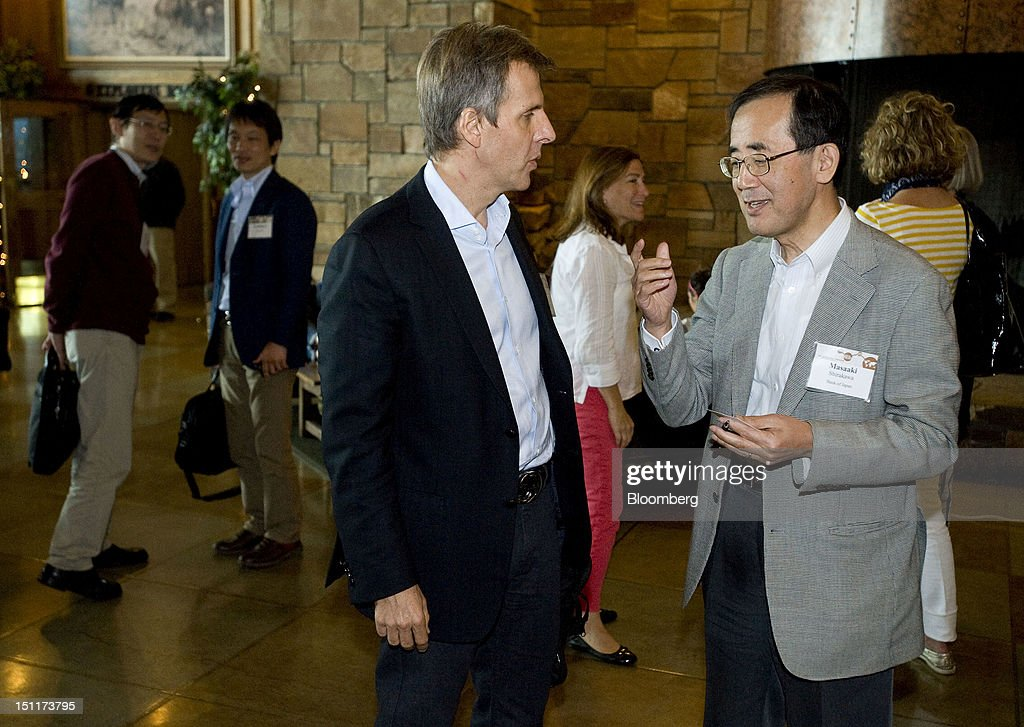 Martin Redrado, professor of international economics at the Catholic University of Buenos Aires, center, speaks with Masaaki Shirakawa, governor of the Bank of Japan, right, while leaving the economic symposium sponsored by the Kansas City Federal Reserve Bank at the Jackson Lake Lodge in Moran, Wyoming, U.S., on Saturday, Sept. 1, 2012. Ben S. Bernanke, chairman of the U.S. Federal Reserve, with a little more than a year left in his second term, defended the effectiveness of unconventional monetary policies such as bond purchases and signaled he would soon deploy them again to attack unemployment. Photographer: Price Chambers/Bloomberg via Getty Images