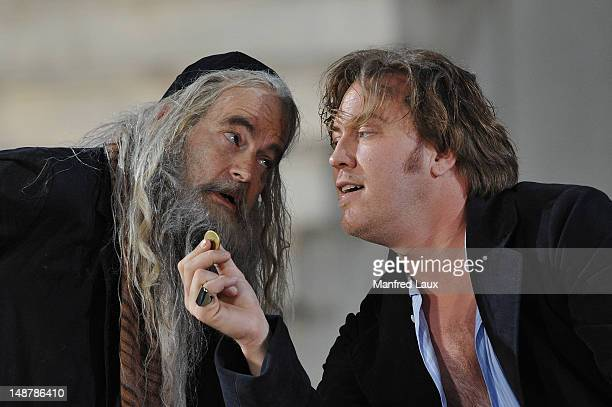 Martin Reinke and Nicolas Ofczarek is seen during the photo rehearsal of 'Jedermann' on the Domplatz ahead of Salzburg Festival 2012 on July 19 2012...