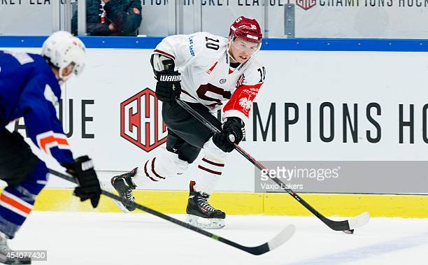 Martin Reway of Sparta Prague is handling the puck during the Champions Hockey League group stage game between Vaxjo Lakers and Sparta Prague on...