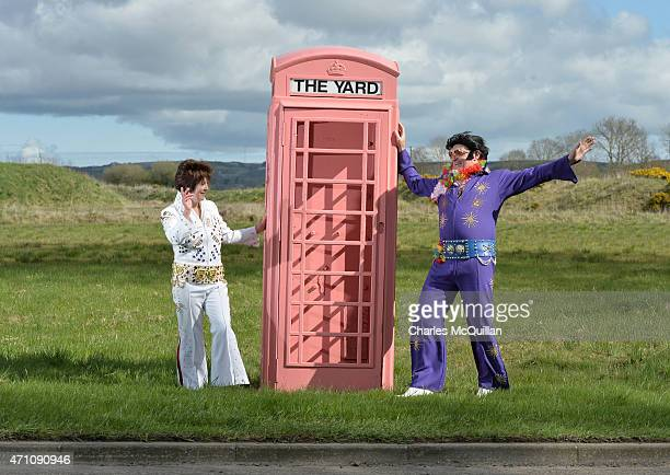 Martin Rice also known as 'Big Elvis' poses near a pink phone booth along with Mary Faulkner at the Guinness Book of World Record for the largest...
