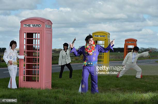 Martin Rice also known as 'Big Elvis' poses near pink yellow and orange phone booths along with other Elvis impersonators at the Guinness Book of...