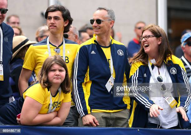 Martin Richard's family from left Jane Henry Bill and Denise watch the 121st Boston Marathon at the finish line VIP stands on April 17 2017 Martin...