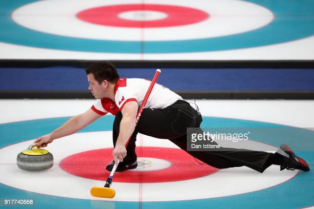 Martin Rios of Switzerland delivers a stone against Canada during the Curling Mixed Doubles Gold Medal Game on day four of the PyeongChang 2018...