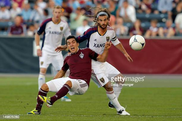Martin Rivero of Colorado Rapids is fouled by Kyle Beckerman of Real Salt Lake as they battle for control of the ball at Dick's Sporting Goods Park...