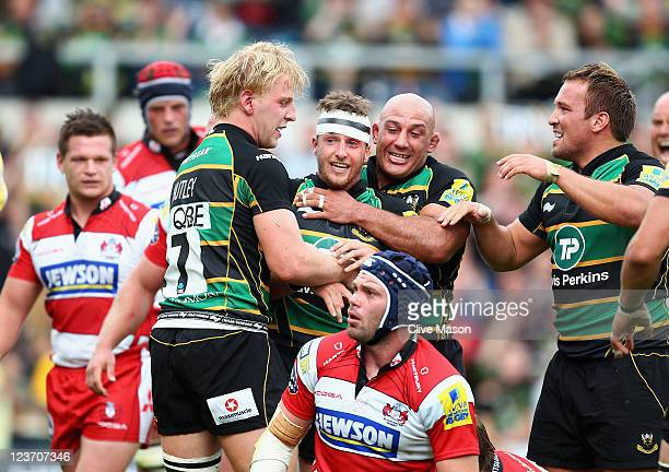 Martin Roberts of Northampton Saints is congratulated after scoring a try during the AVIVA Premiership match between Northampton Saints and...