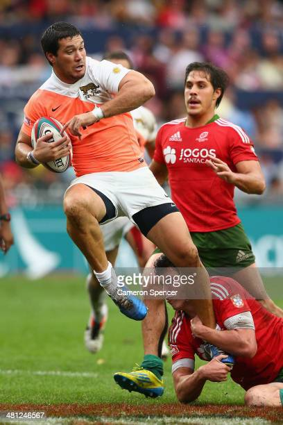 Martin Rodriguez of Argentina is tackled during the Pool C match between Argentina and Portugal during the 2014 Hong Kong Sevens at Hong Kong...