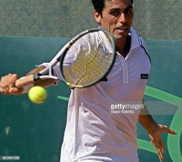 Martin Rodriguez of Argentina returns the ball during a match against his compatriot Gaston Gaudio during the Mexican Tennis Open on 27 February 2001...