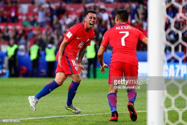 Martin Rodriguez of Chile celebrates scoring his side's first goal with teammate Alexis Sanchez during the FIFA Confederations Cup Russia 2017 Group...