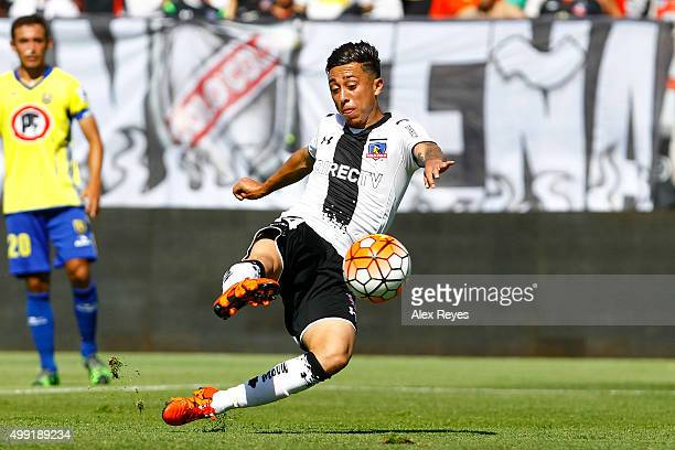 Martin Rodriguez of Colo Colo shoots to score the opening goal during a match between Colo Colo and U de Concepcion as part of 14th round of...