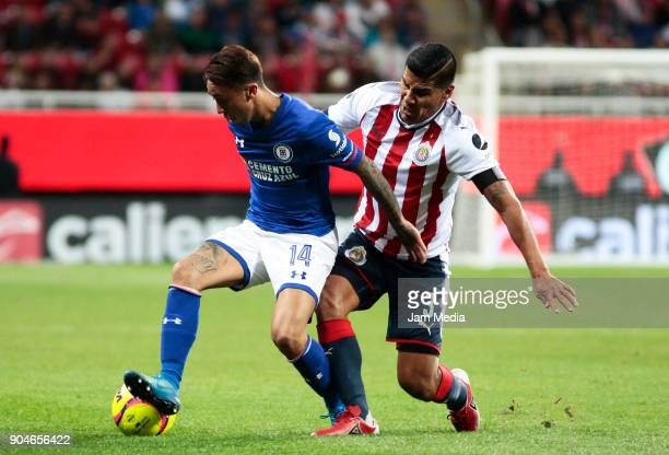 Martin Rodriguez of Cruz Azul fights for the ball wih Carlos Salcido of Chivas during the 2nd round match between Chivas and Cruz Azul as part of the...