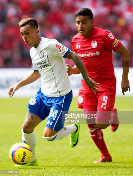 Martin Rodriguez of Cruz Azul fights for the ball with Ernesto Vega of Toluca during the 4th round match between Toluca and Cruz Azul as part of the...