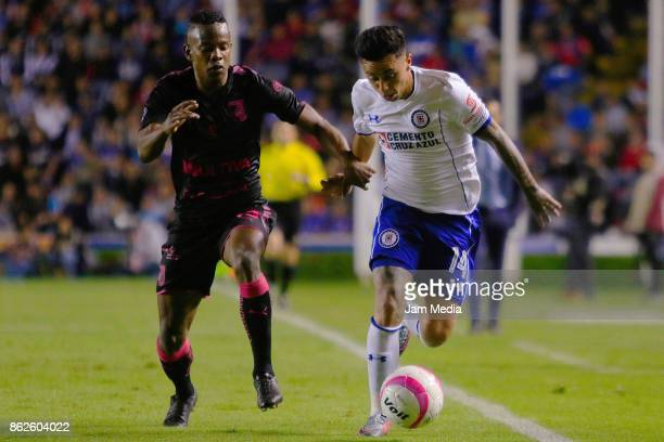 Martin Rodriguez of Cruz Azul fights for the ball with Yerson Candelo of Queretaro during the 10th round match between Queretaro and Cruz Azul as...
