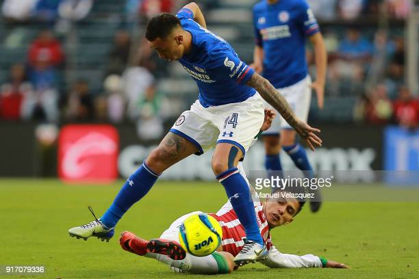 Martin Rodriguez of Cruz Azul struggles for the ball against Dieter Villalpando of Necaxa during the 6th round match between Cruz Azul and Necaxa as...