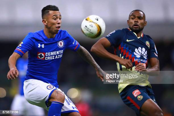 Martin Rodriguez of Cruz Azul struggles for the ball with William Da Silva of America during the quarter finals second leg match between America and...