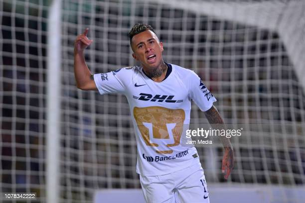 Martin Rodriguez of Pumas celebrates after scoring the equalizer during the semifinal first leg match between Pumas UNAM and America as part of the...
