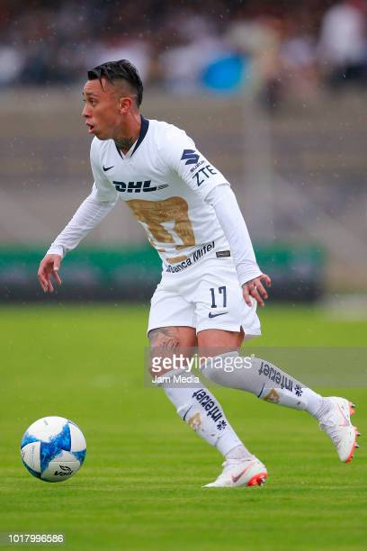 Martin Rodriguez of Pumas drives the ball during the fourth round match between Pumas UNAM and Pachuca as part of the Torneo Apertura 2018 Liga MX at...