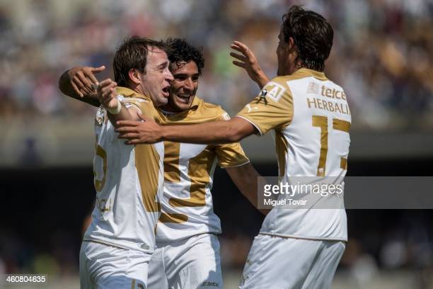 Martin Romagnoli and his teammtes of Pumas celebrate a scored goal against Puebla during a match between Pumas UNAM and Puebla as part of the...