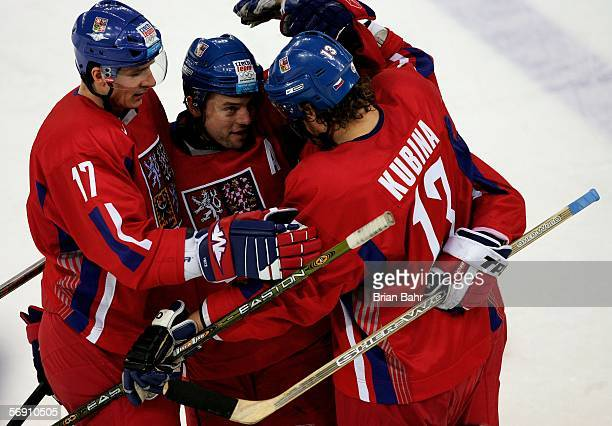 Martin Rucinsky of Czech Republic celebrates with his teammates Pavel Kubina and Filip Kuba after he scored past Goalkeeper Peter Budaj of Slovakia...