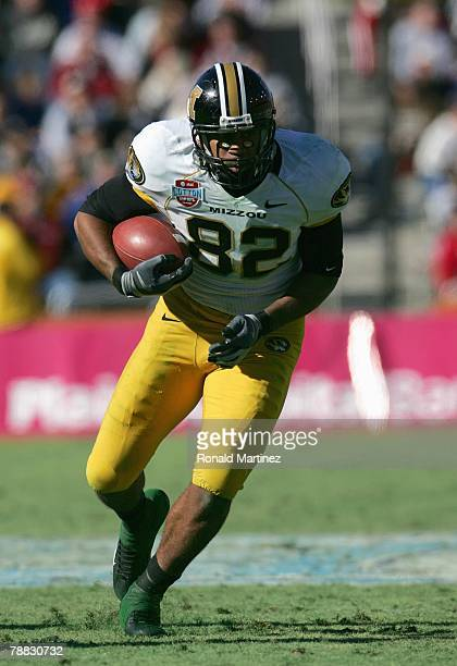 Martin Rucker of the Missouri Tigers carries the ball against the Arkansas Razorbacks during the ATT Cotton Bowl Classic on January 1 2008 at the...