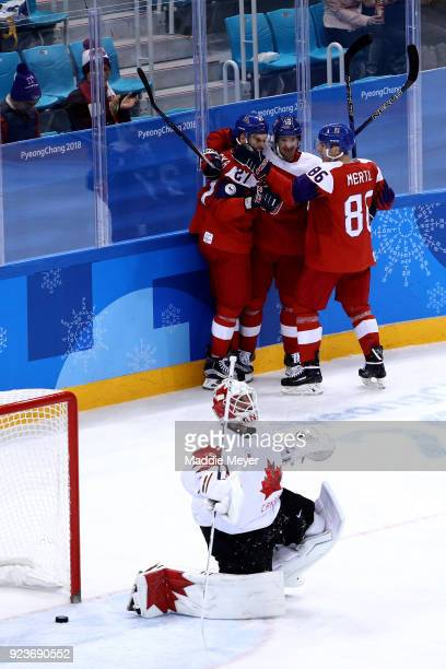 Martin Ruzicka of the Czech Republic celebrates with teammates after scoring in the first period against Kevin Poulin of Canada during the Men's...