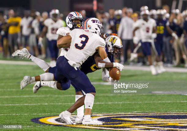Martin safetys Porter Streator III and Brandon Anderson try to break up a catch made by Murray State receiver Malik Honeycutt during the college...