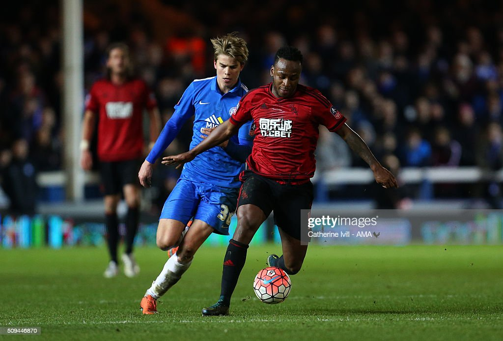 Martin Samuelsen of Peterborough United and Saido Berahino of West Bromwich Albion during the Emirates FA Cup match between Peterborough United and West Bromwich Albion at ABAX Stadium on February 10, 2016 in Peterborough, England.