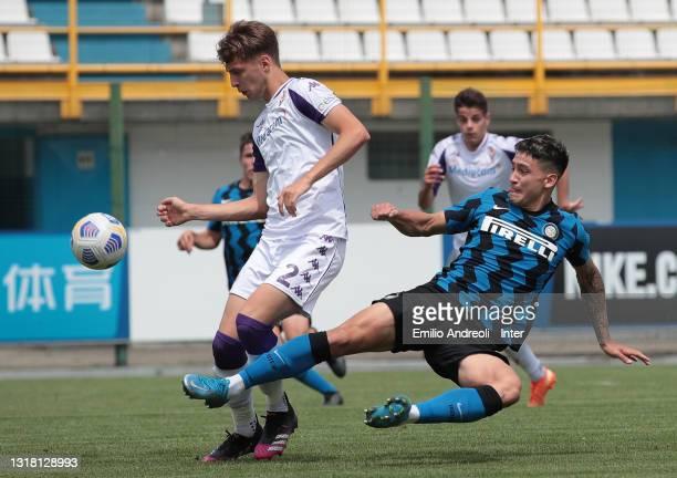 Martin Satriano Costa of FC Internazionale U19 is challenged by Filippo Frison of ACF Fiorentina U19during the Primavera 1 TIM match between FC...