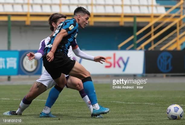 Martin Satriano Costa of FC Internazionale U19 is challenged by Mattia Fiorini of ACF Fiorentina U19during the Primavera 1 TIM match between FC...