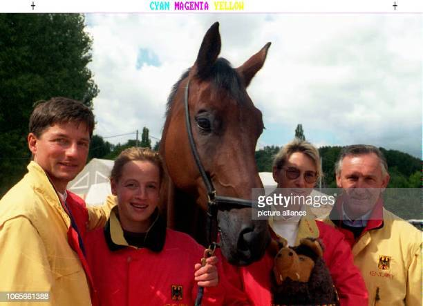 Martin Schaudt Isabell Werth with her horse Amaretto Nicole UphoffBeck with mascot and Klaus Balkenhol representing the German colors in the team...
