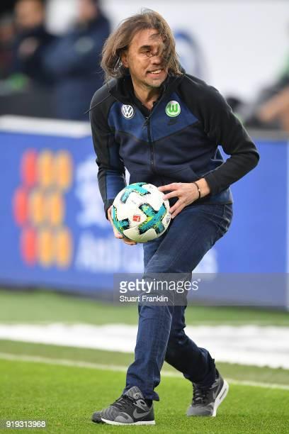 Martin Schmidt coach of Wolfsburg reaches for the ball during the Bundesliga match between VfL Wolfsburg and FC Bayern Muenchen at Volkswagen Arena...