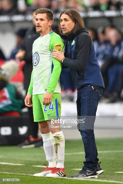 Martin Schmidt coach of Wolfsburg talks with Sebastian Jung of Wolfsburg during the Bundesliga match between VfL Wolfsburg and FC Bayern Muenchen at...