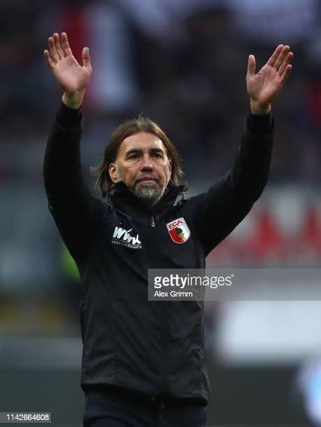 Martin Schmidt, head coach of Augsburg celebrates his team's win after the Bundesliga match between Eintracht Frankfurt and FC Augsburg at...