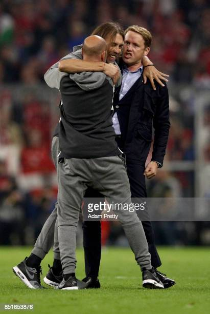 Martin Schmidt new head coach of Wolfsburg celebrate with sport director Olaf Rebbe after the Bundesliga match between FC Bayern Muenchen and VfL...