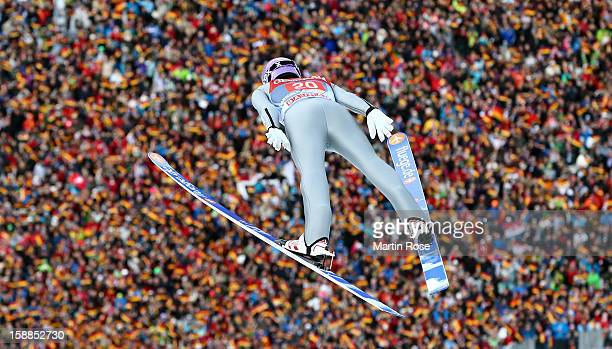 Martin Schmitt of Germany competes during the final round for the FIS Ski Jumping World Cup event of the 61st Four Hills ski jumping tournament at...