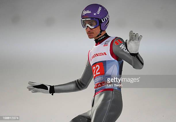 Martin Schmitt of Germany competes during the final round second leg for the FIS Ski Jumping World Cup event at the 61st Four Hills ski jumping...