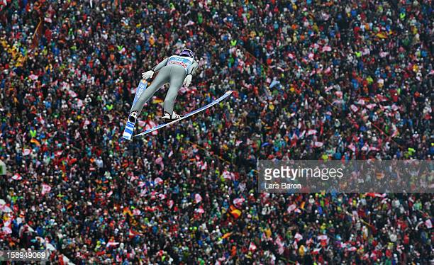 Martin Schmitt of Germany competes during the first round for the FIS Ski Jumping World Cup event of the 61st Four Hills ski jumping tournament at...