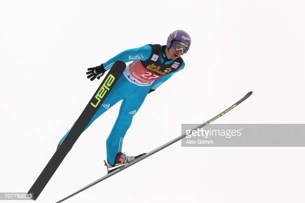 Martin Schmitt of Germany competes during the training round for the FIS Ski Jumping World Cup event at the 59th Four Hills ski jumping tournament at...