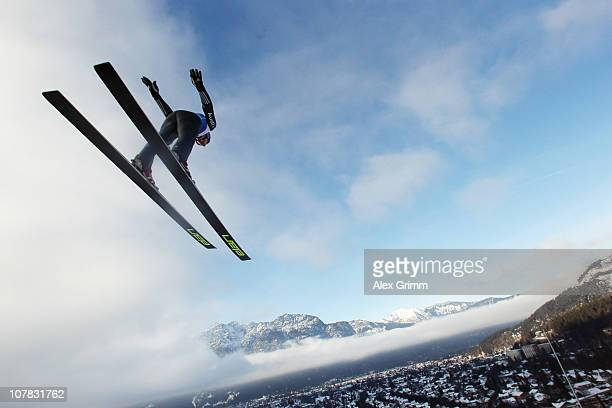 Martin Schmitt of Germany competes during the training round for the FIS Ski Jumping World Cup event of the 59th Four Hills ski jumping tournament at...