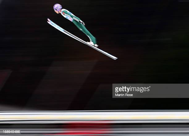 Martin Schmitt of Germany competes during the trial round for the FIS Ski Jumping World Cup event of the 61st Four Hills ski jumping tournament at...