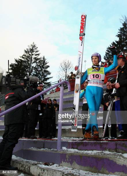 Martin Schmitt of Germany finishing third attends the victory ceremony after the FIS Ski Jumping World Cup at the 57th Four Hills Ski Jumping...