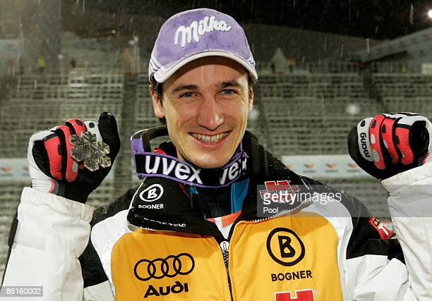 Martin Schmitt of Germany poses with the Silver medal won during the Men's Ski Jumping Individual 134M Hill competition at the FIS Nordic World Ski...
