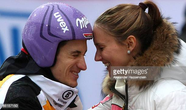 Martin Schmitt of Germany smiles with his girlfriend Patricia after missing the final round of the Large Hil event at FIS Nordic World Ski...