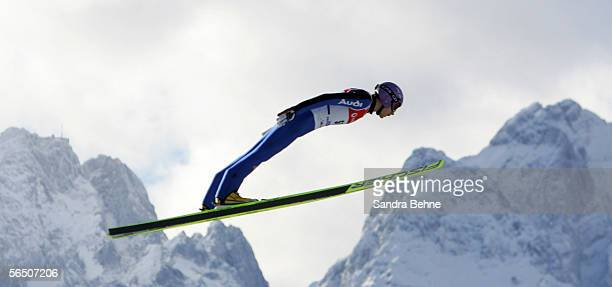 Martin Schmitt of Germany soars through th air in front of the mountain Zugspitze during training for the FIS Ski Jumping World Cup event at the 54th...