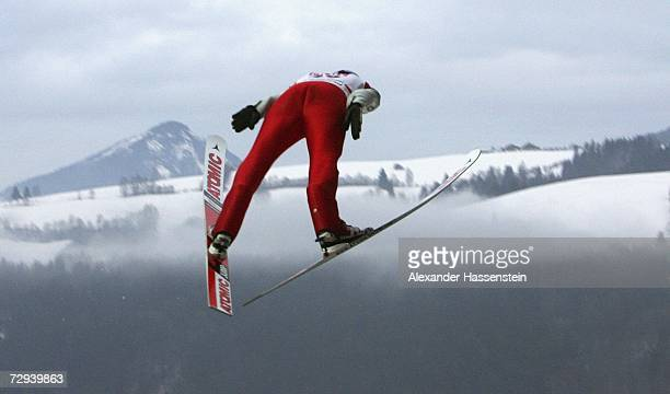 Martin Schmitt of Germany soars through the air during a practice session for the FIS Ski Jumping World Cup event at the 55th Four Hills Ski Jumping...