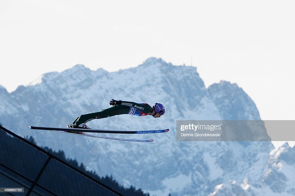 Martin Schmitt of Germany soars through the air during his training jump at Olympia Skistadion on January 1, 2014 in Garmisch-Partenkirchen, Germany.