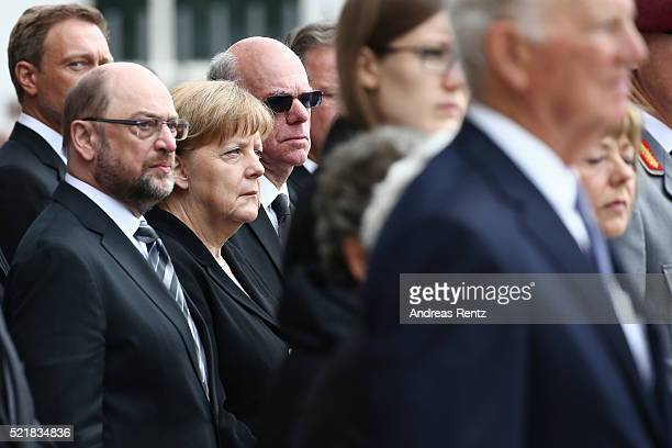 Martin Schulz and German Chancellor Angela Merkel mourn during the state memorial ceremony to honor HansDietrich Genscher on April 17 2016 in Bonn...