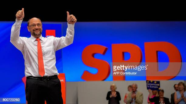 Martin Schulz chairman of Germany's social democratic SPD party and candidate for chancellor holds his thumbs up as he is applauded for his speech...