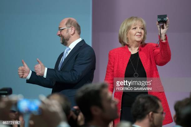 Martin Schulz, chairman of the social democratic SPD party and candidate for Chancellor, poses on the stage with Hannelore Kraft, State Premier of...